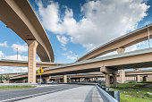 Modern highway overpass in a busy Miami morning.
