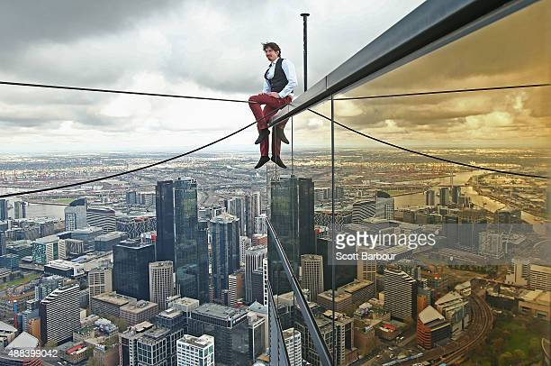 Highwire artist Kane Petersen prepares before successfully walking a tightrope 300 metres above the ground at Eureka Skydeck on September 16 2015 in...