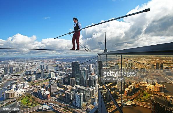 Highwire artist Kane Petersen successfully walks a tightrope 300 metres above the ground at Eureka Skydeck on September 16 2015 in Melbourne...