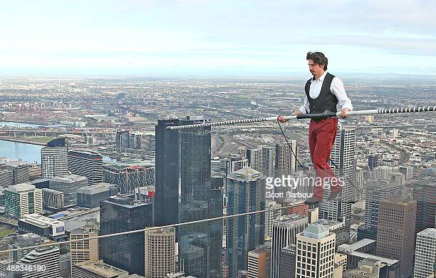 Highwire artist Kane Petersen walks a tightrope 300 metres above the ground at Eureka Skydeck on September 16 2015 in Melbourne Australia The walk...