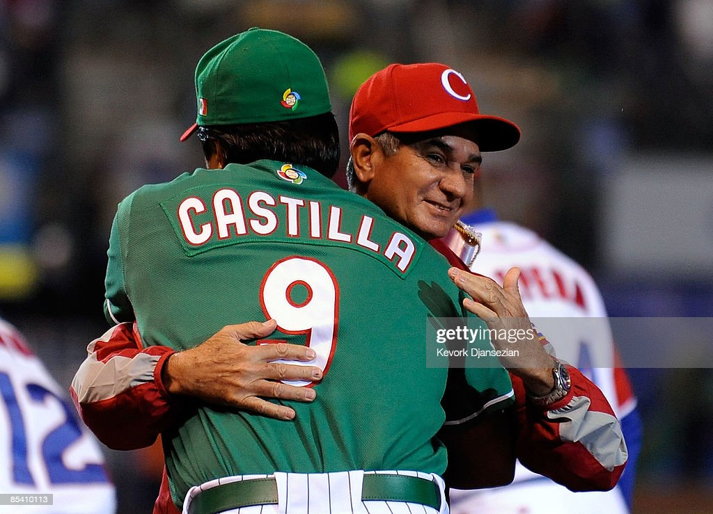 Higinio Velez (L) manager of Cuba hugs his counterpart Vinny Castilla #9 of Mexico during the 2009 World Baseball Classic Pool B match on March 12, 2009 at the Estadio Foro Sol in Mexico City, Mexico.