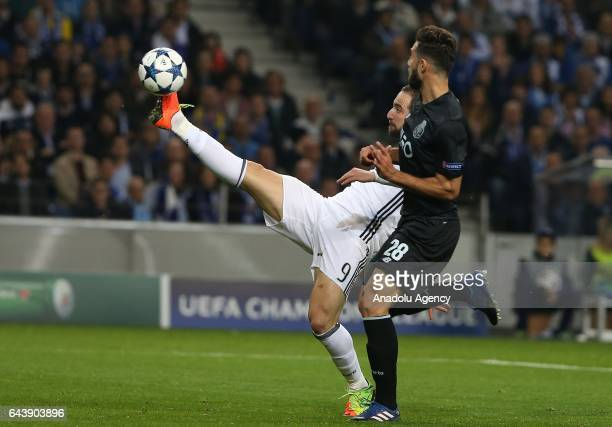 Higuain of Juventus in action against Felipe of FC Porto during the UEFA Champions League round of 16 match between FC Porto and Juventus at Estadio...