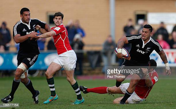 Hika Elliot of New Zealand Maori All Blacks is tackled by Mark Irish during the RFU Championship XV and New Zealand Maori All Blacks rugby match at...