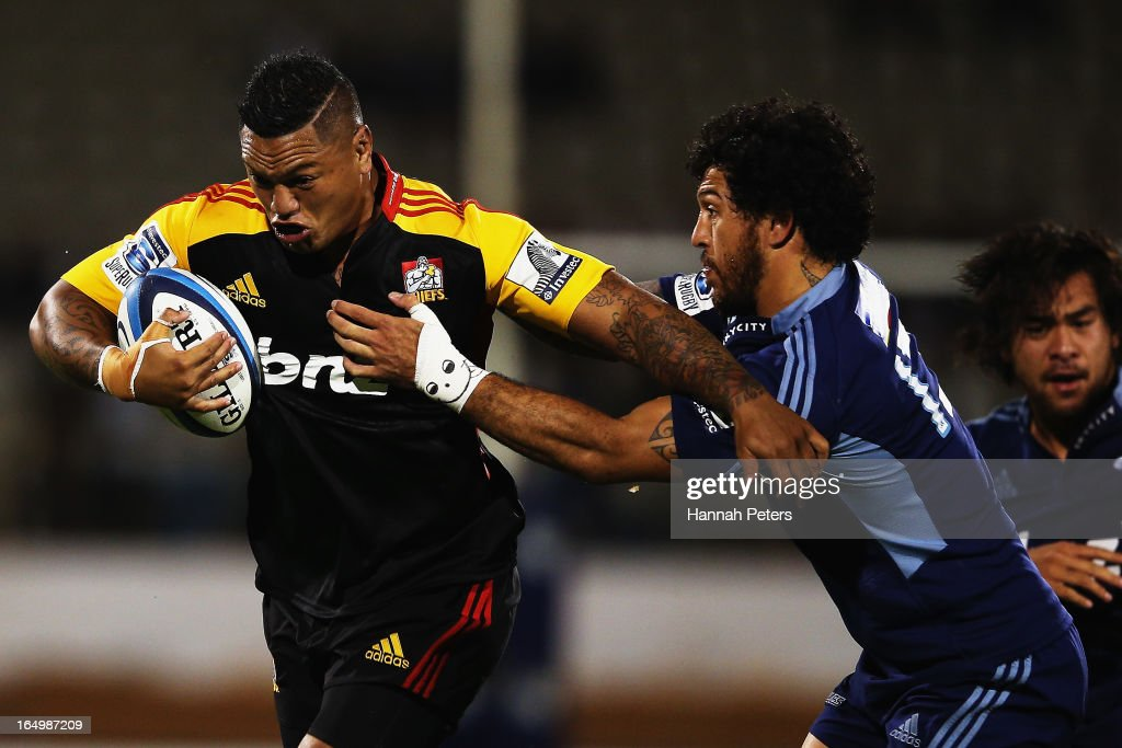 Hika Elliot of the Chiefs fends off <a gi-track='captionPersonalityLinkClicked' href=/galleries/search?phrase=Rene+Ranger&family=editorial&specificpeople=1175061 ng-click='$event.stopPropagation()'>Rene Ranger</a> of the Blues during the round seven Super Rugby match between the Chiefs and the Blues at Bay Park on March 30, 2013 in Tauranga, New Zealand.