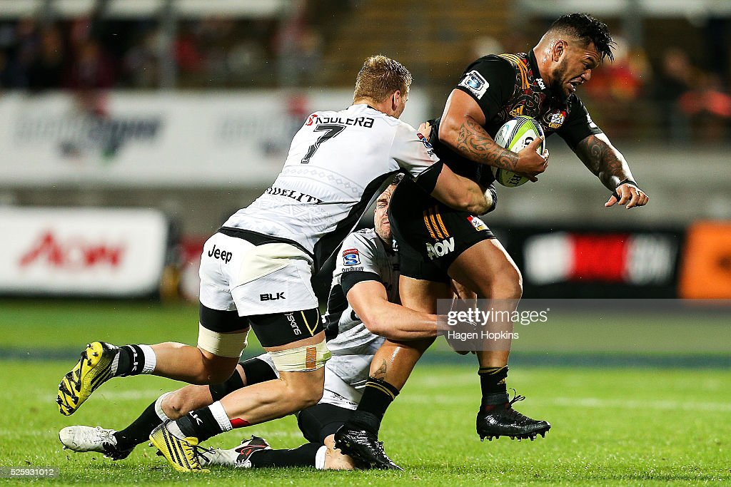 Hika Elliot of the Chiefs is tackled by Keegan Daniel and Jean-Luc du Preez of the Sharks during the round 10 Super Rugby match between the Chiefs and the Sharks at Yarrow Stadium on April 29, 2016 in New Plymouth, New Zealand.
