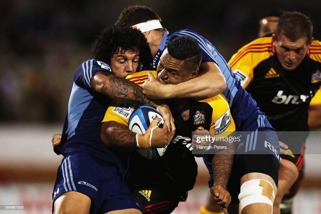 Hika Elliot of the Chiefs is tackled by <a gi-track='captionPersonalityLinkClicked' href=/galleries/search?phrase=Rene+Ranger&family=editorial&specificpeople=1175061 ng-click='$event.stopPropagation()'>Rene Ranger</a> of the Blues during the round seven Super Rugby match between the Chiefs and the Blues at Bay Park on March 30, 2013 in Tauranga, New Zealand.