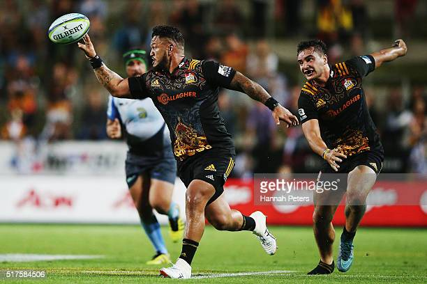 Hika Elliot of the Chiefs offloads the ball during the round five Super Rugby match between the Chiefs and the Western Force at FMG Stadium on March...