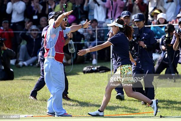 Hikari Fujita of Japan celebrates her winning putt with her caddie during the third round of Fujisankei Ladies Classic at the Kawana Hotel Golf...