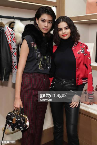 Hikari Mori and Selena Gomez pose during the Coach InStore Event with Selena Gomez at Coach Boutique on September 13 2017 in New York City
