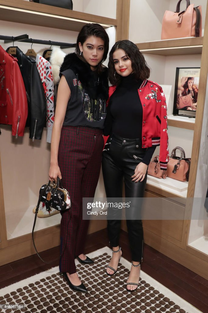 Hikari Mori (L) and Selena Gomez pose during the Coach In-Store Event with Selena Gomez at Coach Boutique on September 13, 2017 in New York City.