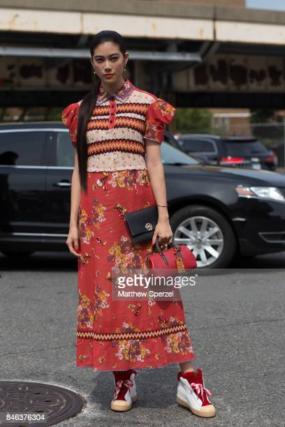 Hikari Mori is seen attending Coach during New York Fashion Week wearing a red dress on September 12 2017 in New York City