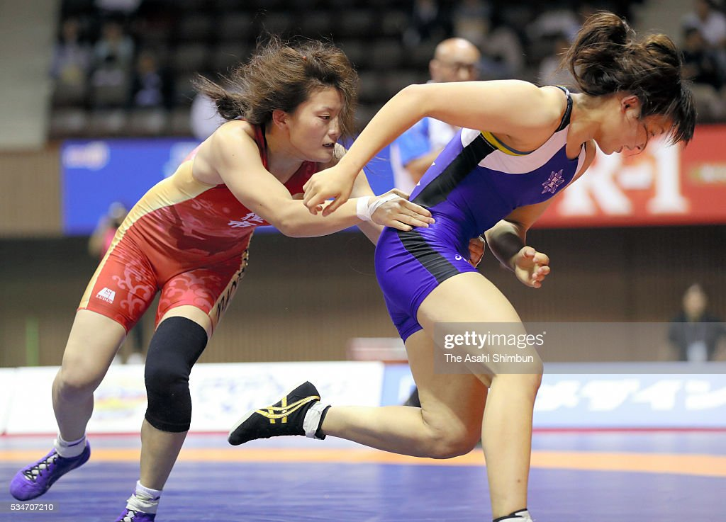 Hikari Sugawara (red) and Momoka Kadoya (red) compete in the Women's -55kg final during day one of the All Japan Wrestling Invitational Championships at the Yoyogi National Gymnasium on May 27, 2016 in Tokyo, Japan.