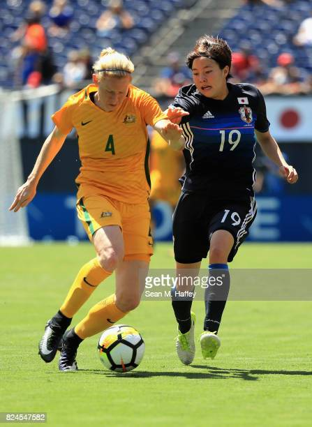 Hikaru Kitagawa of Japan battles Clare Polkinghorne of Australia for a loose ball during the first half of a match in the 2017 Tournament of Nations...