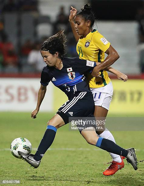 Hikaru Kitagawa of Japan holds off Geyse of Brazil during the FIFA U20 Women's World Cup Papua New Guinea 2016 Quarter Final match between Japan and...