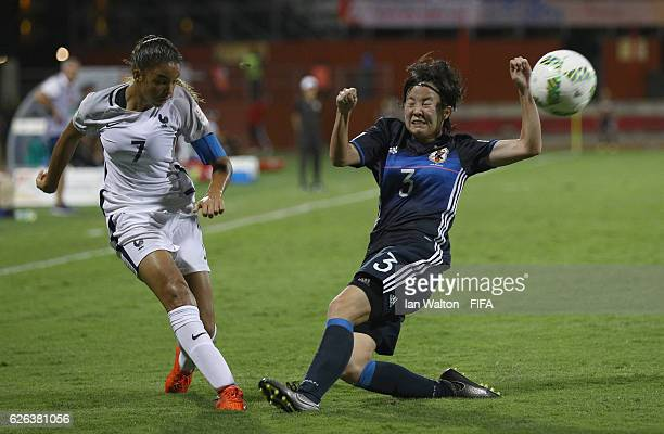 Hikaru Kitagawa of Japan tries to tackle Delphine Cascarino of France during the FIFA U20 Women's World Cup Semi Final match between Japan and France...