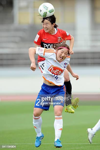 Hikaru Kitagawa of Urawa Reds and Aya Saeki of Albirex Niigata compete for the ball during the Nadeshiko League Cup Group B match between Urawa Red...