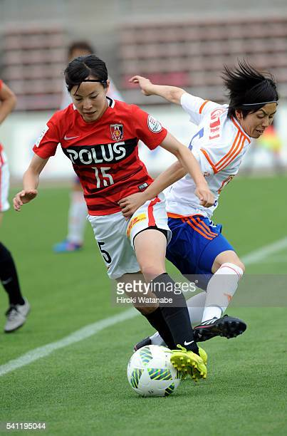 Hikaru Kitagawa of Urawa Reds and Haruka Takahashi of Albirex Niigata compete for the ball during the Nadeshiko League Cup Group B match between...