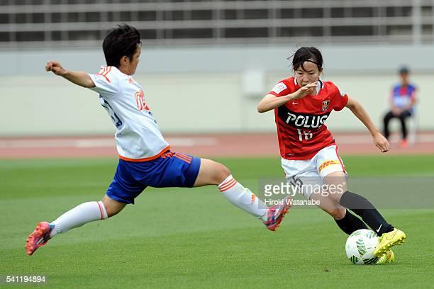 Hikaru Kitagawa of Urawa Reds and Shoko Yamada of Albirex Niigata compete for the ball during the Nadeshiko League Cup Group B match between Urawa...