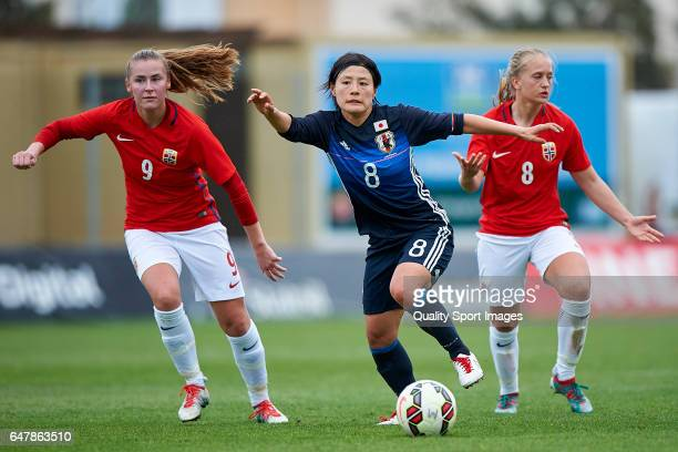 Hikaru Naomoto of Japan competes for the ball with Tonje Pedersen and Amalie Vevle Eikeland of Norway during the international friendly match between...