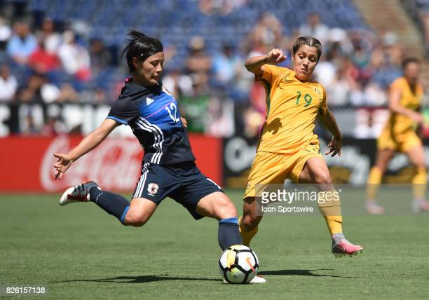 Hikaru Naomoto of Japan passes the ball against Katrina Gorry of Australia during the Tournament of Nations soccer match between Japan and Australia...
