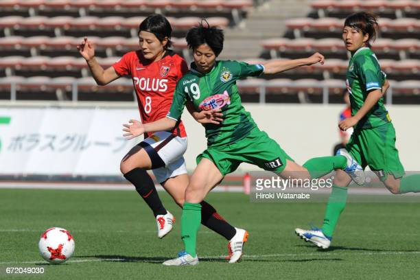Hikaru Naomoto of Urawa Red Diamonds Ladies and Riko Ueki of NTV Beleza compete for the ball during the Nadeshiko League match between Diamonds...