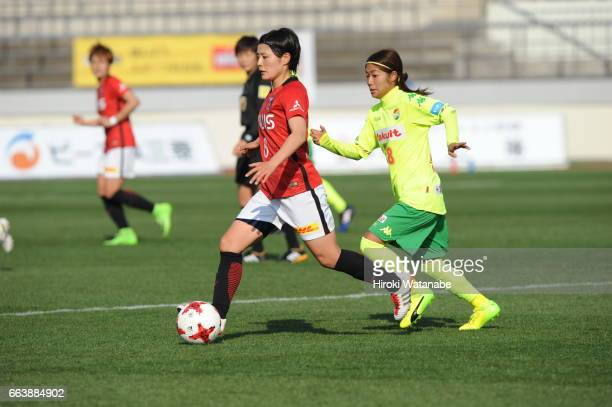Hikaru Naomoto of Urawa Red Diamonds Ladies and Yuka Anzai of JEF United Chiba Ladies compete for the ball during the Nadeshiko League match between...