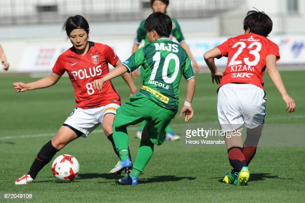 Hikaru Naomoto of Urawa Red Diamonds Ladies and Yuka Momiki of NTV Beleza compete for the ball during the Nadeshiko League match between Diamonds...
