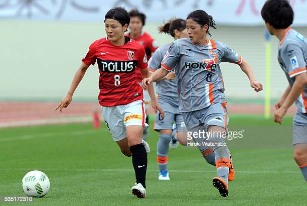 Hikaru Naomoto of Urawa Reds Ladies and Shiho Kunisawa of AC Nagano Parceiro compete for the ball during the Nadeshiko League match between Urawa Red...