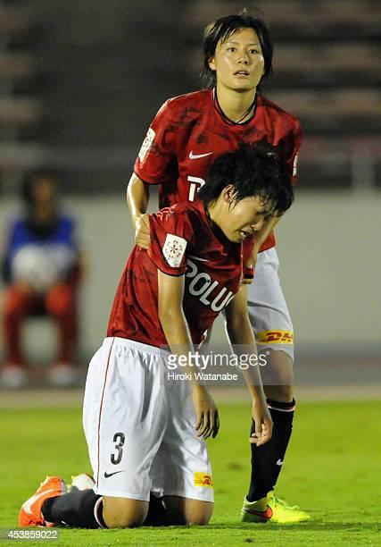 Hikaru Naomoto of Urawa Reds Ladies helps Shiho Kohata stand up after the 01 defeat in the Nadeshiko League match between Urawa Red Diamonds Ladies...