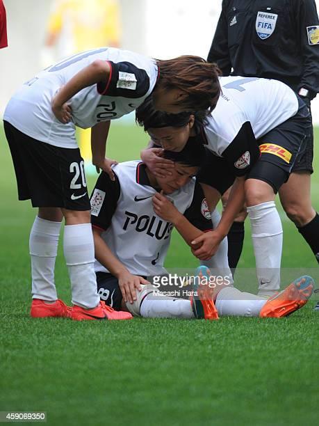 Hikaru Naomoto of Urawa Reds Ladies looks injured during the Nadeshiko League match between INAC Kobe Leonessa and Urawa Red Diamonds Ladies at...