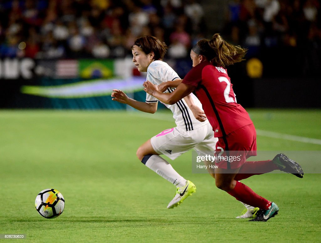 Hikaru Oya #19 of Japan dribbles by Mallory Pugh #22 of the United States during a 3-0 United States win in the 2017 Tournament Of Nations at StubHub Center on August 3, 2017 in Carson, California.