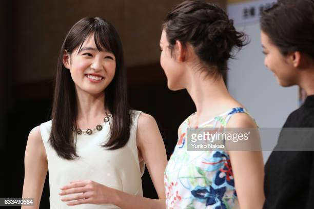 Hikaru Takahashi smiles as Ayame Goriki and Emi Takei look on during the press conference for the 15th National Pretty Young Girl Contest on February...