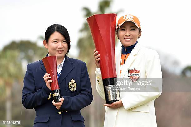 Hikaru Yoshimoto of Japan and BoMee Lee of South Korea pose with the trophy during the final round of the Yokohama Tire PRGR Ladies Cup at the Tosa...