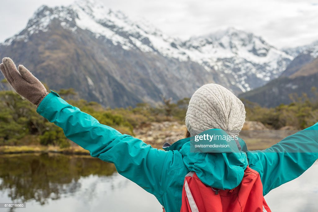 Hiker arms outstretched in mountain scenery : Stock Photo