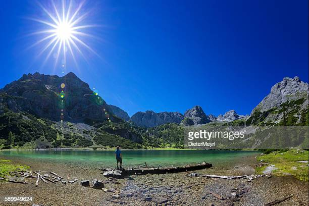 Hiker at alpin Lake at sunny day - Seebensee Tirol