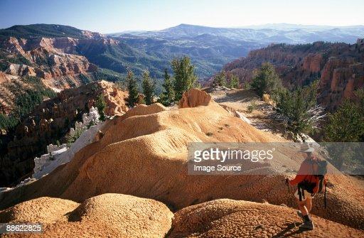 Hiker at cedar breaks national monument : Stock Photo