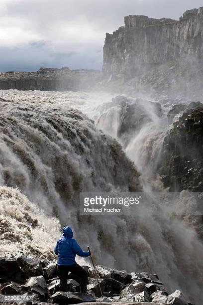Hiker at Dettifoss Waterfall, Joekulsargljufur, Iceland, Europe