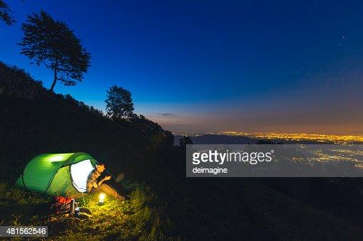 Hiker camping at night
