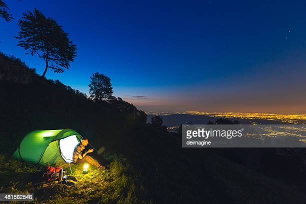 Hiker camping at night
