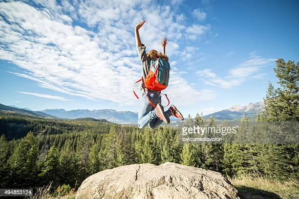 Hiker celebrating at mountain top