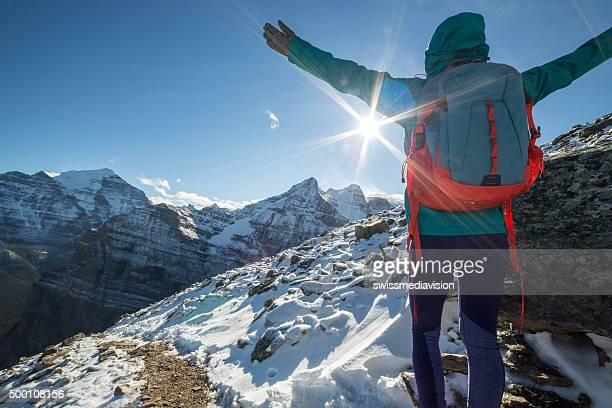 Hiker celebrating on mountain top