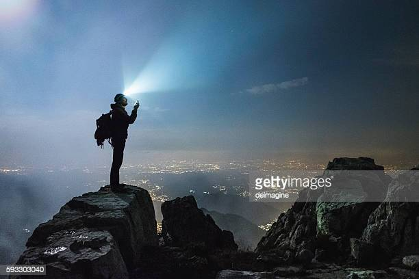 Hiker checks your device on top on the mount