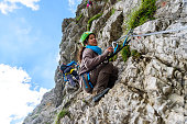 Hiker climbing in the mountain of Alps, Europe - extreme sports
