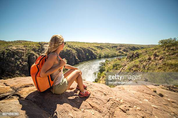 Hiker contemplating spectacular landscape