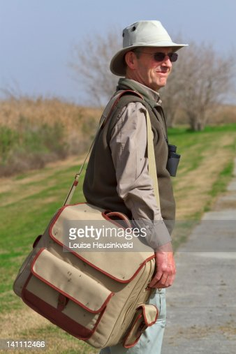 Hiker covered in mosquitoes : Stock Photo