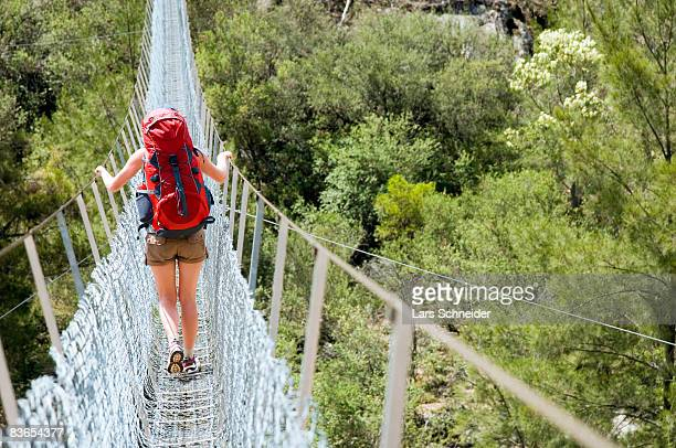 Hiker crossing the Bowtell Swing Bridge.