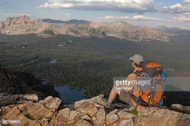 Hiker Enjoying View From Peak in Uinta Mountains