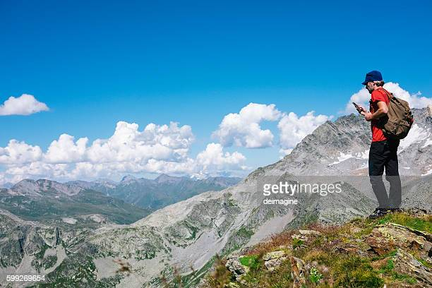 Hiker enjoying view of mountain ranges from the top peak