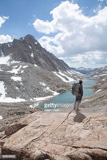 Hiker enjoys the views above the Darwin Lakes California.