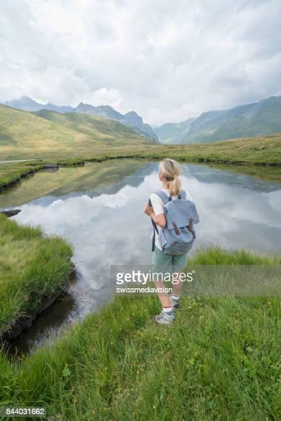 Hiker female looking at beautiful landscape